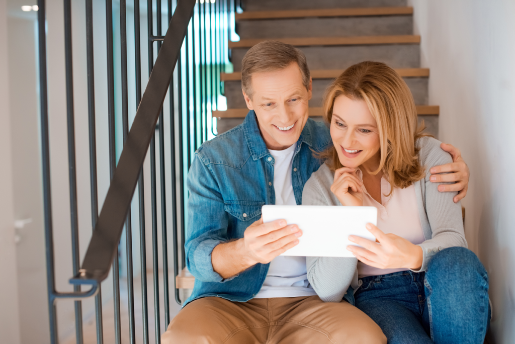 couple using tablet on stairs